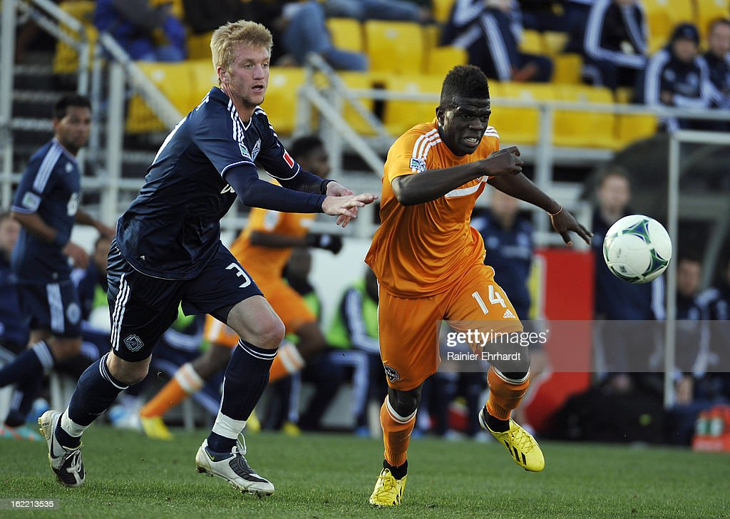 Adam Clement #33 of the Vancouver Whitecaps FC and Jason Johnson #14 of the Houston Dynamo battle for the ball during the first half of a game on February 20, 2013 in Charleston, North Carolina.