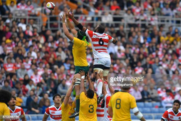 Adam Coleman and Michael Leitch of Japan compete for the lineout ball during the international match between Japan and Australia at Nissan Stadium on...