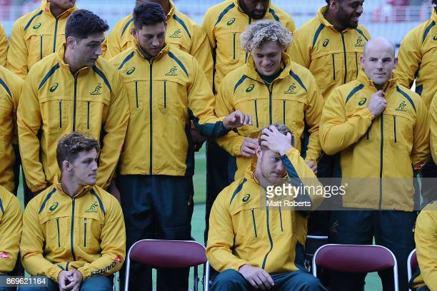 Adam Coleman and Ned Hanigan adjust the hair of Matt Philip during the team photo prior to the Australia Captain's Run at Nissan Stadium on November...