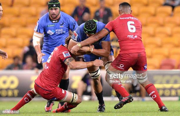Adam Coleman of the Western Force takes on the defence during the round 14 Super Rugby match between the Reds and the Force at Suncorp Stadium on May...