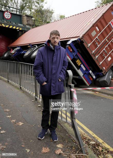 Adam Coleman outside his home in Dover Kent after a lorry struck a railway bridge narrowly missing the property
