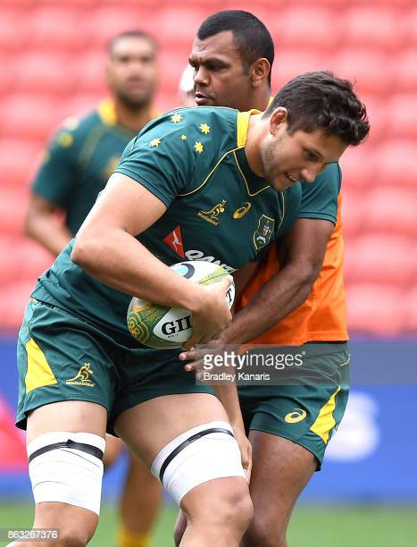 Adam Coleman runs into the defence of Kurtley Beale during the Australian Wallabies Captain's Run at Suncorp Stadium on October 20 2017 in Brisbane...