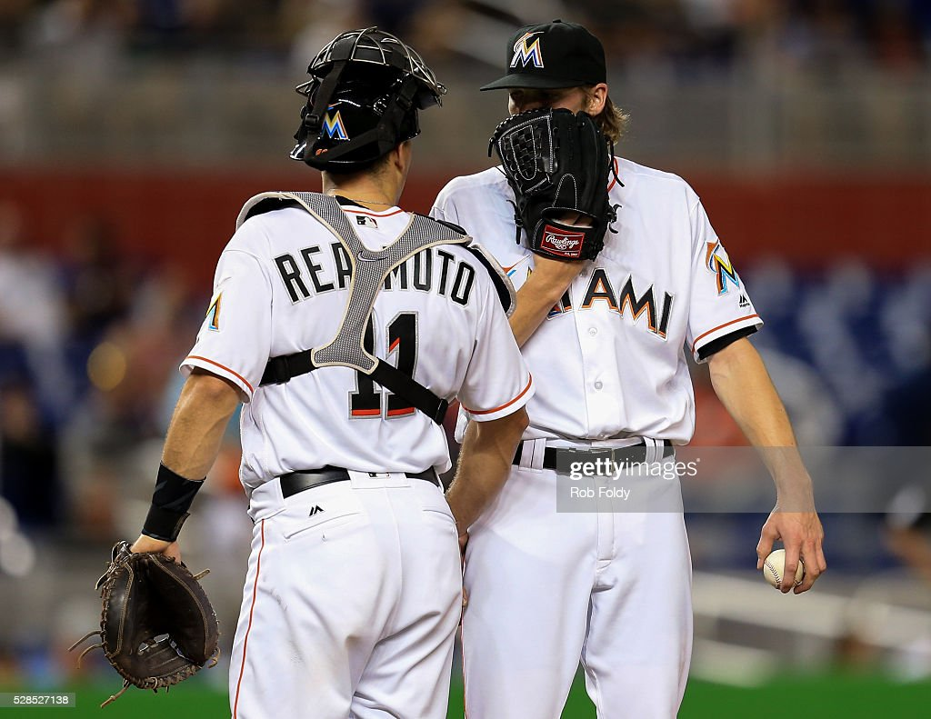 Adam Conley #61 of the Miami Marlins talks with <a gi-track='captionPersonalityLinkClicked' href=/galleries/search?phrase=J.T.+Realmuto&family=editorial&specificpeople=10507745 ng-click='$event.stopPropagation()'>J.T. Realmuto</a> #11 during the game against the Arizona Diamondbacks at Marlins Park on May 5, 2016 in Miami, Florida.