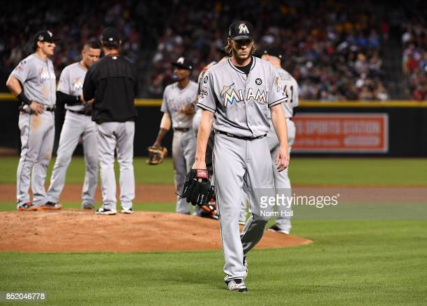 Adam Conley of the Miami Marlins walks back to his dugout after being taken out of the game during the second inning against the Arizona Diamondbacks...