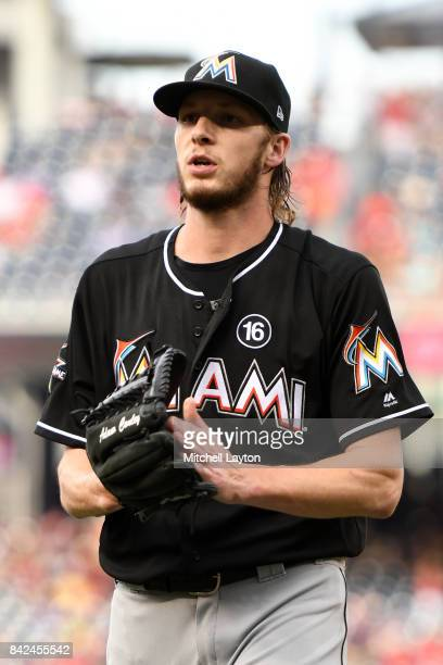 Adam Conley of the Miami Marlins walks back to the dug out during a baseball game against the Washington Nationals at Nationals Park on August 30...
