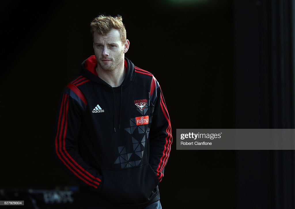<a gi-track='captionPersonalityLinkClicked' href=/galleries/search?phrase=Adam+Cooney&family=editorial&specificpeople=208786 ng-click='$event.stopPropagation()'>Adam Cooney</a> of the Bombers arrives for a press conference during an Essendon Bombers AFL training session at True Value Solar Centre on May 4, 2016 in Melbourne, Australia.