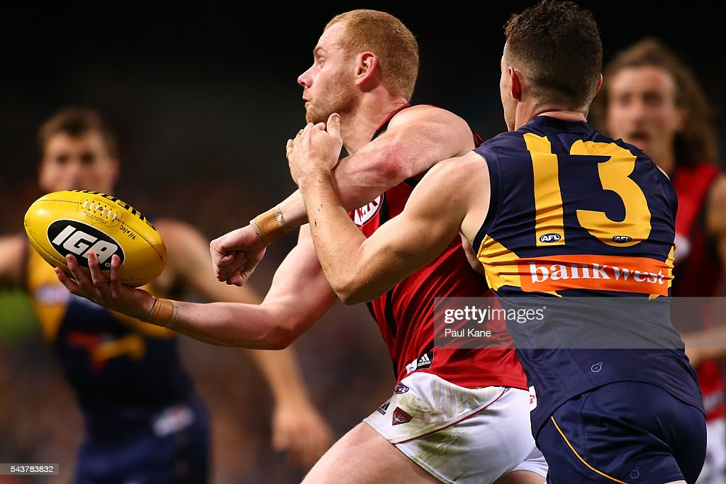 <a gi-track='captionPersonalityLinkClicked' href=/galleries/search?phrase=Adam+Cooney&family=editorial&specificpeople=208786 ng-click='$event.stopPropagation()'>Adam Cooney</a> of the Bombers looks to handball during the round 15 AFL match between the West Coast Eagles and the Essendon Bombers at Domain Stadium on June 30, 2016 in Perth, Australia.