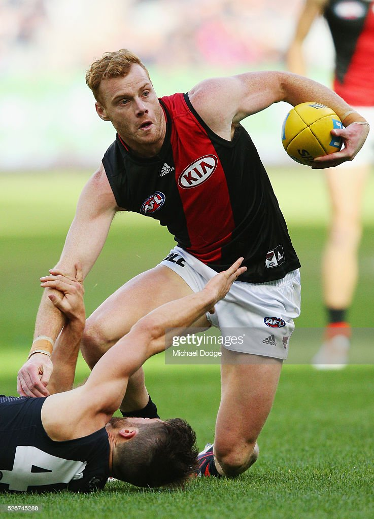 Adam Cooney of the Bombers wins the ball during the round six AFL match between the Carlton Blues and the Essendon Bombers at Melbourne Cricket Ground on May 1, 2016 in Melbourne, Australia.
