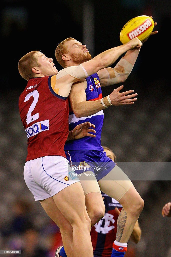 <a gi-track='captionPersonalityLinkClicked' href=/galleries/search?phrase=Adam+Cooney&family=editorial&specificpeople=208786 ng-click='$event.stopPropagation()'>Adam Cooney</a> of the Bulldogs flies for a mark as Ryan Harwood of the Lions spoils during the round 13 AFL match between the Western Bulldogs and the Brisbane Lions at Etihad Stadium on June 23, 2012 in Melbourne, Australia.