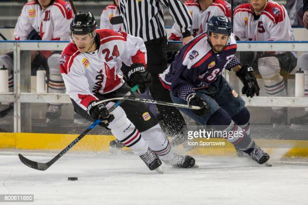 Adam Cracknell of Team Canada changes direction with the puck with Nick Lazorko of Team USA in pursuit during the Melbourne Game of the Ice Hockey...