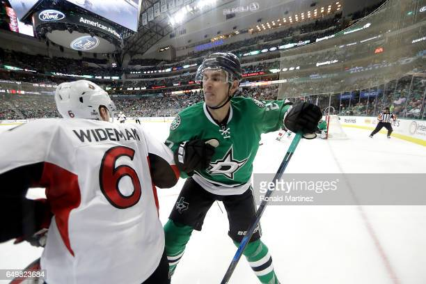 Adam Cracknell of the Dallas Stars checks Chris Wideman of the Ottawa Senators in the second period at American Airlines Center on March 8 2017 in...