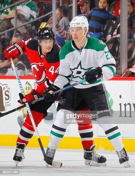 Adam Cracknell of the Dallas Stars in action against Miles Wood of the New Jersey Devils on March 26 2017 at Prudential Center in Newark New Jersey...