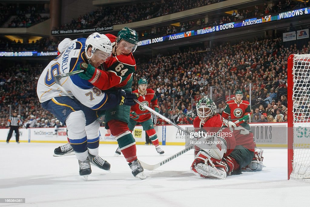 <a gi-track='captionPersonalityLinkClicked' href=/galleries/search?phrase=Adam+Cracknell&family=editorial&specificpeople=2221797 ng-click='$event.stopPropagation()'>Adam Cracknell</a> #79 of the St. Louis Blues attempts to score against <a gi-track='captionPersonalityLinkClicked' href=/galleries/search?phrase=Mikael+Granlund&family=editorial&specificpeople=5649678 ng-click='$event.stopPropagation()'>Mikael Granlund</a> #64 and goalie Niklas Backstrom #32 of the Minnesota Wild defending during the game on April 11, 2013 at the Xcel Energy Center in Saint Paul, Minnesota.