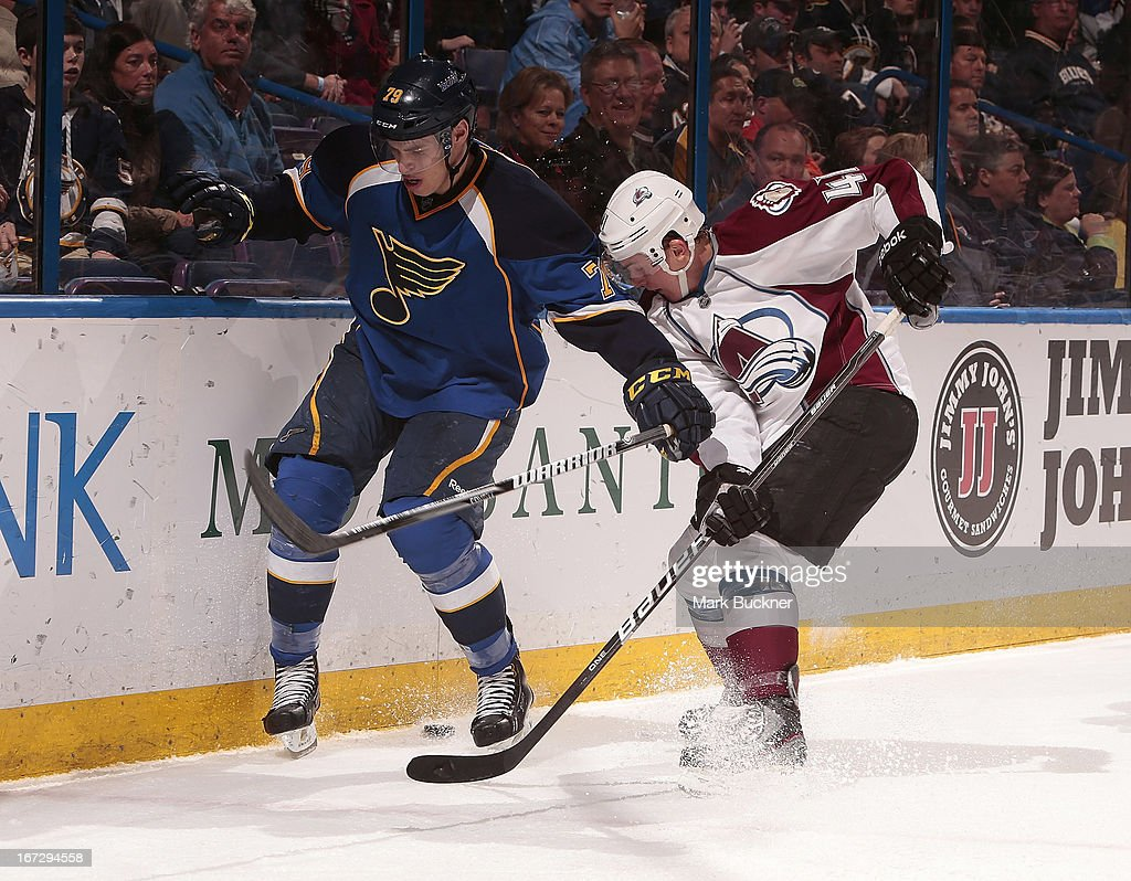<a gi-track='captionPersonalityLinkClicked' href=/galleries/search?phrase=Adam+Cracknell&family=editorial&specificpeople=2221797 ng-click='$event.stopPropagation()'>Adam Cracknell</a> #79 of the St. Louis Blues battles <a gi-track='captionPersonalityLinkClicked' href=/galleries/search?phrase=Tyson+Barrie&family=editorial&specificpeople=4669265 ng-click='$event.stopPropagation()'>Tyson Barrie</a> #41 of the Colorado Avalanche for the loose puck in an NHL game on April 23, 2013 at Scottrade Center in St. Louis, Missouri.