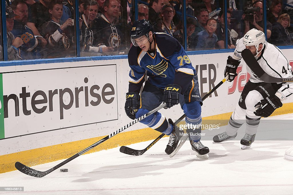 <a gi-track='captionPersonalityLinkClicked' href=/galleries/search?phrase=Adam+Cracknell&family=editorial&specificpeople=2221797 ng-click='$event.stopPropagation()'>Adam Cracknell</a> #79 of the St. Louis Blues handles the puck as <a gi-track='captionPersonalityLinkClicked' href=/galleries/search?phrase=Robyn+Regehr&family=editorial&specificpeople=171828 ng-click='$event.stopPropagation()'>Robyn Regehr</a> #44 of the Los Angeles Kings gives chase in Game Five of the Western Conference Quarterfinals during the 2013 NHL Stanley Cup Playoffs on May 8, 2013 at Scottrade Center in St. Louis, Missouri.