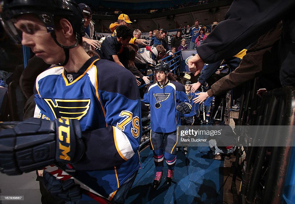 Adam Cracknell #79, Patrik Berglund #21 and Kevin Shattenkirk #22 of the St. Louis Blues are greeted by the fans as they take the ice for warmups before an NHL game against the Edmonton Oilers on March 1, 2013 at Scottrade Center in St. Louis, Missouri.