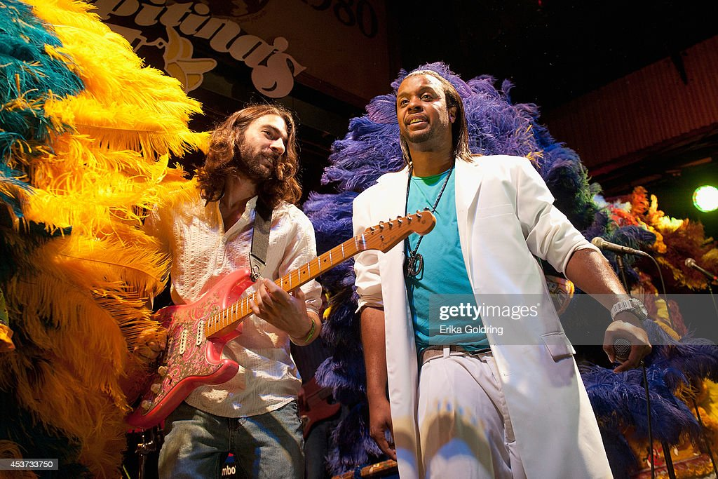 Adam Crochet and Gerard 'Little Bo' Dollis of The Wild Magnolias Mardi Gras Indians perform at Tipitina's on August 16, 2014 in New Orleans, Louisiana.