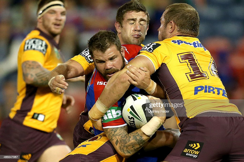 Adam Cuthbertson of the Knights is tackled bythe Broncos defence during the round seven NRL match between the Newcastle Knights and the Brisbane Broncos at Hunter Stadium on April 18, 2014 in Newcastle, Australia.