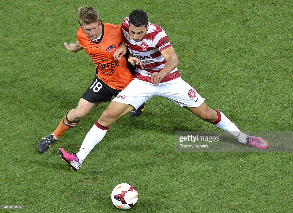 Adam D'Apuzzo of the Wanderers and Luke Brattan of the Roar challenge for the ball during the round seven ALeague match between the Brisbane Roar and...