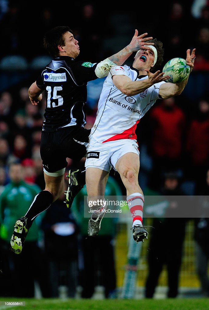 Adam D'Arcy of Ulster jumps for a high ball with Dane HaylettPetty of Biarritz during the Heineken Cup match between Ulster and Biarritz at Ravenhill...