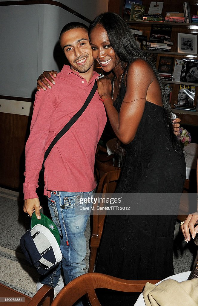 Adam Deacon (L) and Naomi Campbell attend as Naomi Campbell hosts an Olympic Celebration Dinner in partnership with Fashion For Relief, Interview Magazine and Downtown Mayfair celebrating the amazing accomplishments of Team GB on August 9, 2012 in London, United Kingdom. Guest joined event hosts Naomi, Vladislav Doronin and Giuseppe Cipriani at London's Downtown Mayfair. 'The 2012 Olympics have been remarkable - I am elated for Team GB and the extraordinary success they have had so far. It's a very special and proud time to be in London and to celebrate the outstanding talent, which has been showcased during the games. I wish everyone taking part in London 2012 continued strength, determination and perseverance for the remainder of the games.'