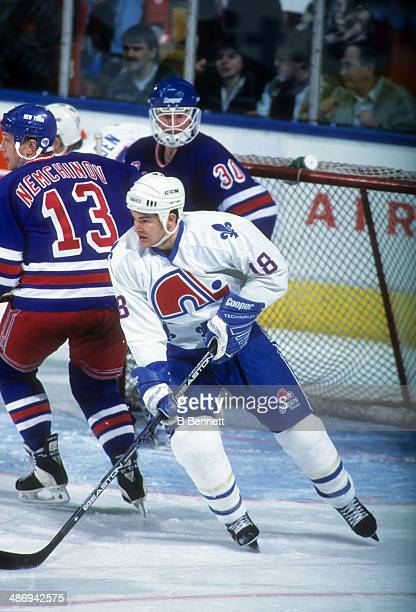 Adam Deadmarsh of the Quebec Nordiques skates on the ice during an NHL game against the New York Rangers on January 28 1995 at the Quebec Coliseum in...