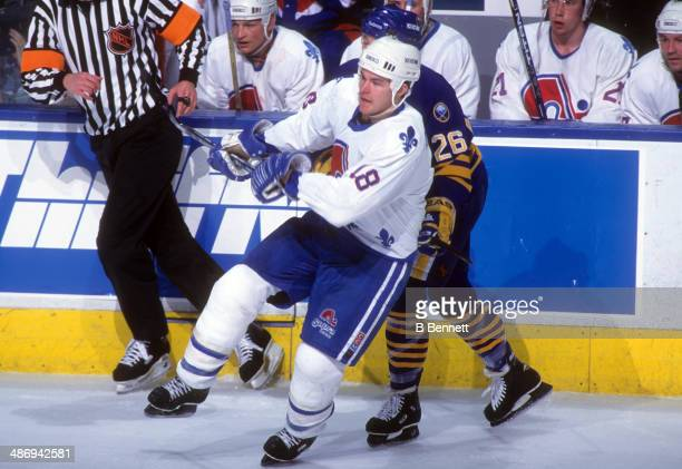 Adam Deadmarsh of the Quebec Nordiques skates on the ice during an NHL game against the Buffalo Sabres on April 14 1995 at the Quebec Coliseum in...