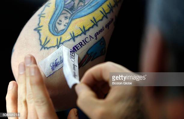 Adam DeMott of Amesbury has the stencil applied for his free Donald Trump tattoo from tattoo artist Bob Holmes at Clay Dragon Tattoo in Seabrook NH...
