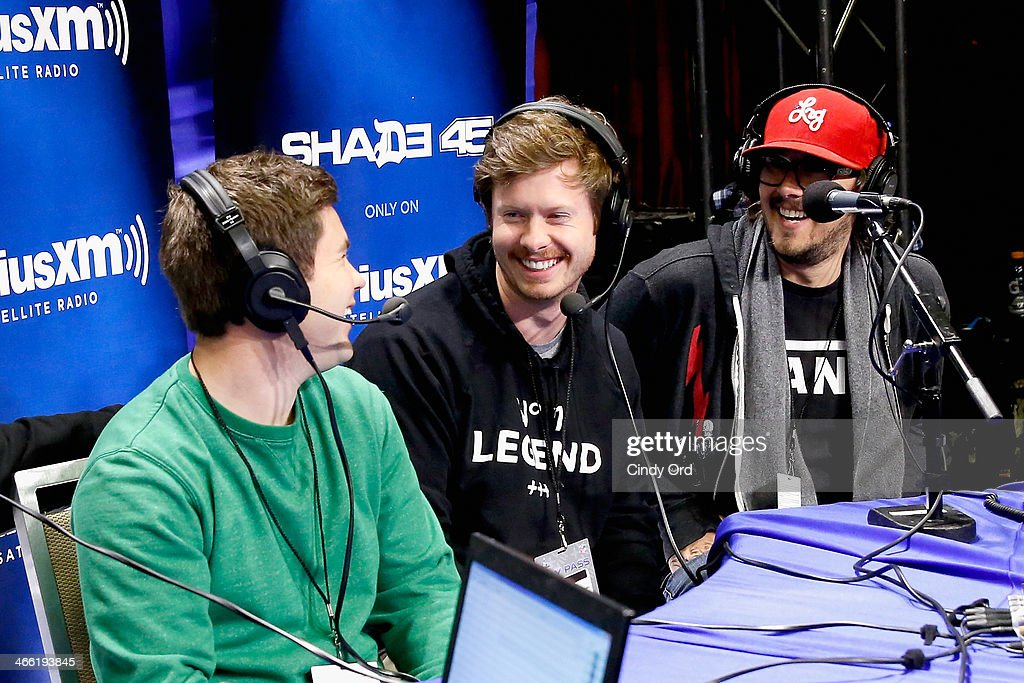 Adam DeVine, Anders Holm and Kyle Newacheck attend SiriusXM at Super Bowl XLVIII Radio Row on January 31, 2014 in New York City.