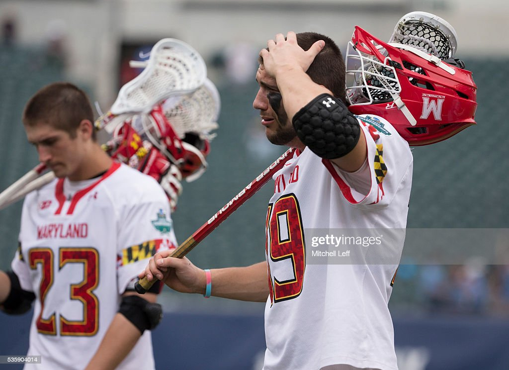 Adam DiMillo #23 and Will Bonaparte #19 of the Maryland Terrapins walk off the field after the game against the North Carolina Tar Heels in the NCAA Division I Men's Lacrosse Championship at Lincoln Financial Field on May 30, 2016 in Philadelphia, Pennsylvania. The Tar Heels defeated the Terrapins 14-13.