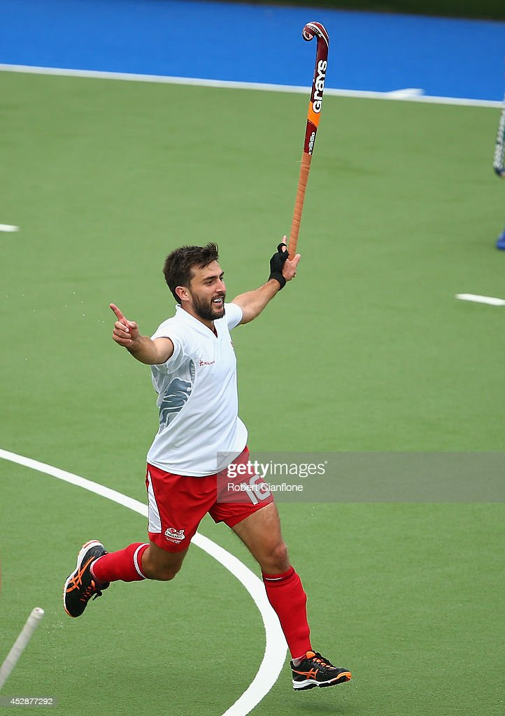 Adam Dixon of Engalnd celebrates after scoring a goal during the men's preliminaries match between New Zealand and England at the Glasgow National Hockey Centre during day six of the Glasgow 2014 Commonwealth Games on July 29, 2014 in Glasgow, United Kingdom.