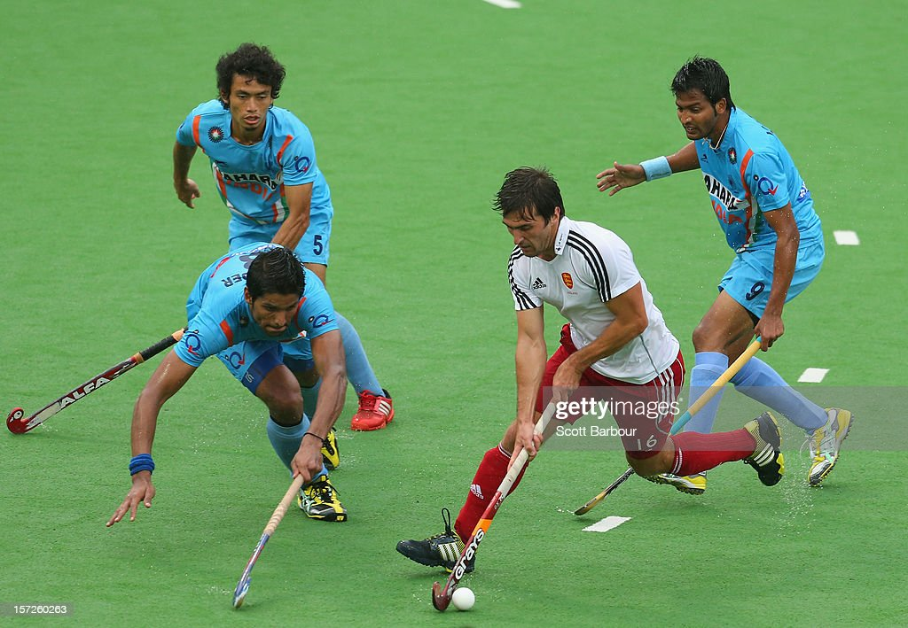 Adam Dixon of England controls the ball during the match between England and India on day one of the Champions Trophy on December 1, 2012 in Melbourne, Australia.