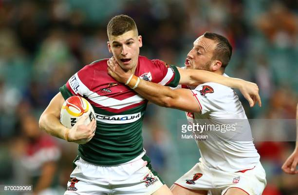 Adam Doueihi of Lebanon is tackled by Josh Hodgson of England during the 2017 Rugby League World Cup match between England and Lebanon at Allianz...