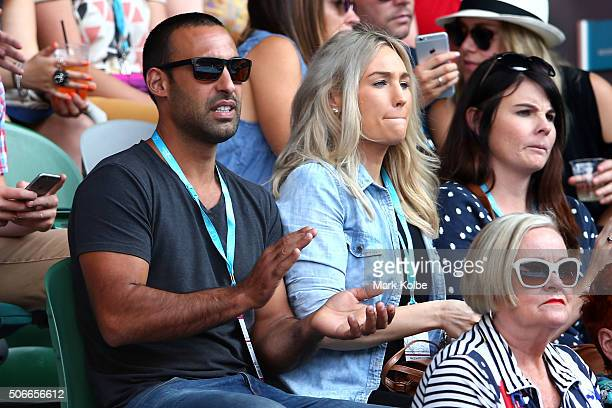 Adam Dovile and wife Lisa Lamond watch the fourth round match between Stan Wawrinka of Switzerland and Milos Raonic of Canada during day eight of the...