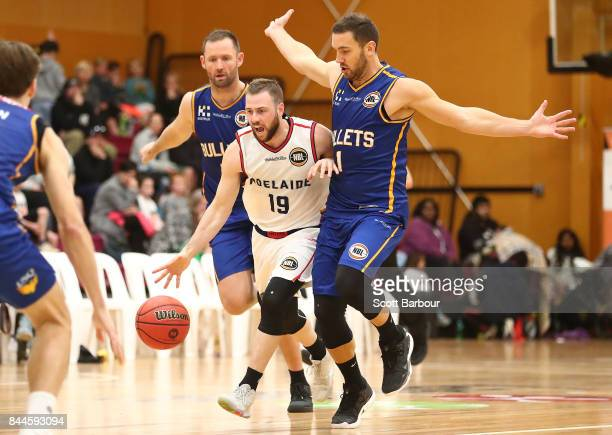 Adam Doyle of the Adelaide 36ers and Adam Gibson of the Bullets compete for the ball during the 2017 NBL Blitz preseason match between the Brisbane...