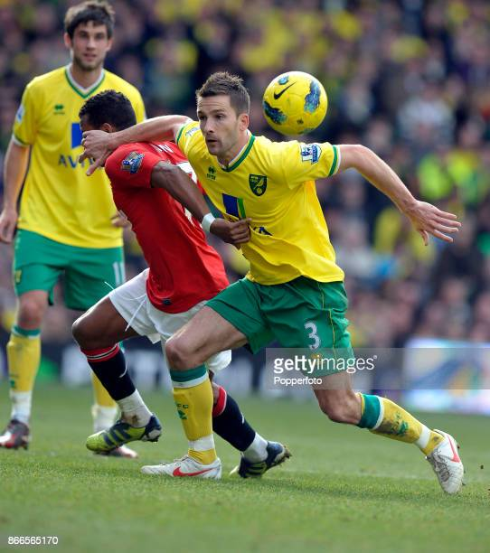 Adam Drury of Norwich City and Nani of Manchester United wrestle for the ball during a Barclays Premier League match at Carrow Road on February 26...