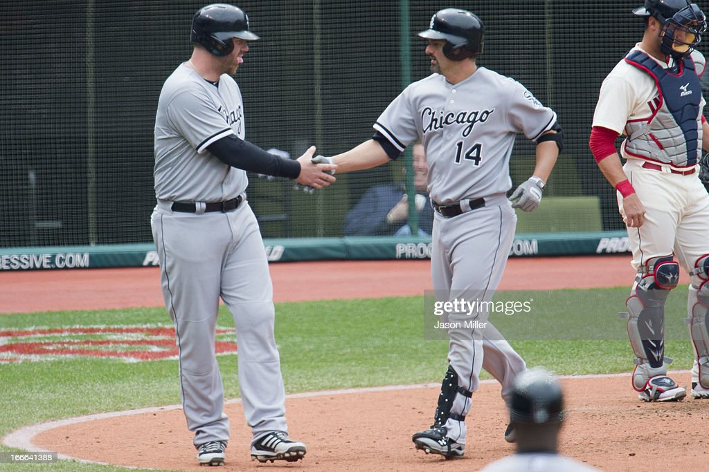 <a gi-track='captionPersonalityLinkClicked' href=/galleries/search?phrase=Adam+Dunn&family=editorial&specificpeople=213505 ng-click='$event.stopPropagation()'>Adam Dunn</a> #32 celebrates with designated hitter <a gi-track='captionPersonalityLinkClicked' href=/galleries/search?phrase=Paul+Konerko&family=editorial&specificpeople=203327 ng-click='$event.stopPropagation()'>Paul Konerko</a> #14 of the Chicago White Sox after Konerko hit a two run home run during the sixth inning against the Cleveland Indians at Progressive Field on April 14, 2013 in Cleveland, Ohio. The White Sox defeated the Indians 3-1.