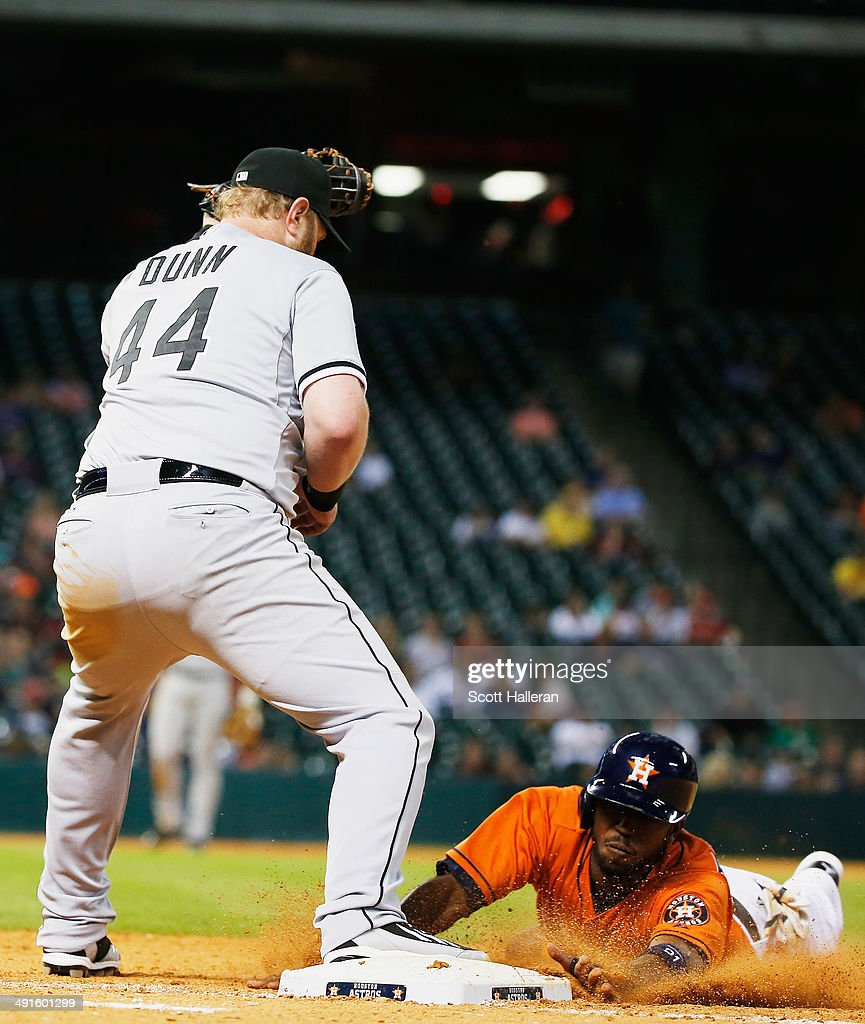 <a gi-track='captionPersonalityLinkClicked' href=/galleries/search?phrase=Adam+Dunn&family=editorial&specificpeople=213505 ng-click='$event.stopPropagation()'>Adam Dunn</a> #44 of the Chicago White Sox forces out <a gi-track='captionPersonalityLinkClicked' href=/galleries/search?phrase=Dexter+Fowler&family=editorial&specificpeople=4949024 ng-click='$event.stopPropagation()'>Dexter Fowler</a> #21 of the Houston Astros out at first base in the seventh inning of their game at Minute Maid Park on May 16, 2014 in Houston, Texas.