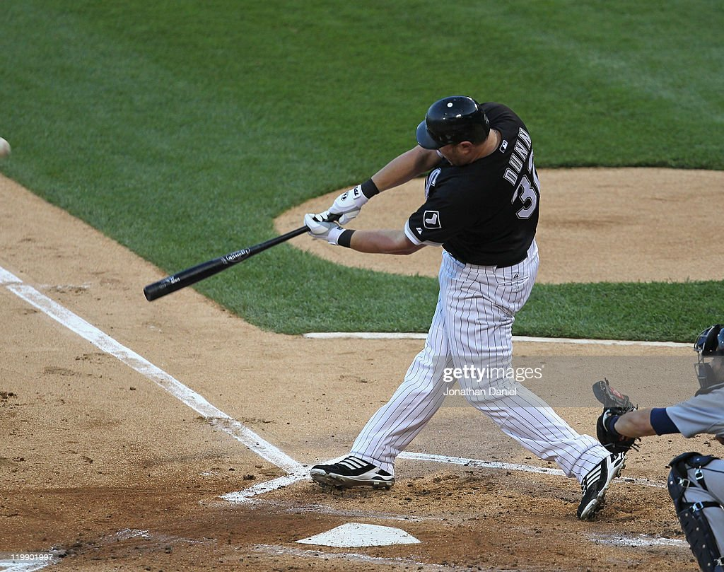 <a gi-track='captionPersonalityLinkClicked' href=/galleries/search?phrase=Adam+Dunn&family=editorial&specificpeople=213505 ng-click='$event.stopPropagation()'>Adam Dunn</a> #32 of the Chicago White Sox hits a two-run home run in the 1st inning against the Detroit Tigers at U.S. Cellular Field on July 26, 2011 in Chicago, Illinois.
