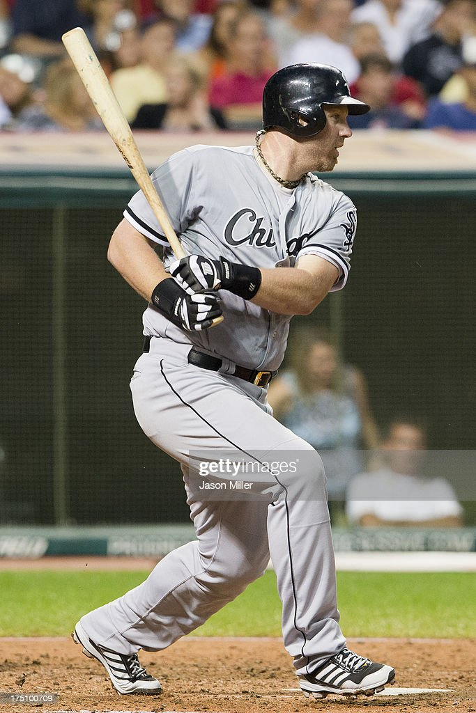 Adam Dunn #32 of the Chicago White Sox hits an RBI single to center during the sixth inning against the Cleveland Indians at Progressive Field on July 31, 2013 in Cleveland, Ohio.