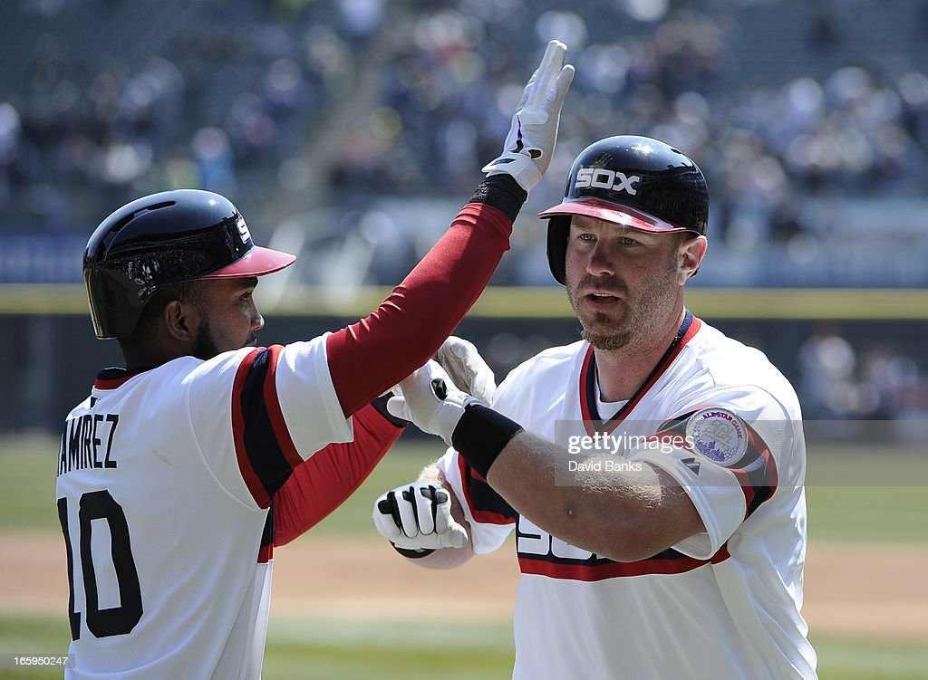 Adam Dunn #32 of the Chicago White Sox is greeted by Alexei Ramirez #10 after hitting two-run homer in the first inning against the Seattle Mariners on April 7, 2013 at U.S. Cellular Field in Chicago, Illinois.