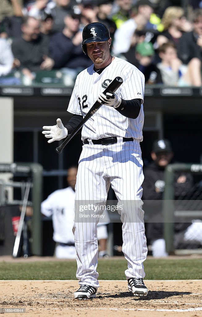 Adam Dunn #32 of the Chicago White Sox looks at his bat after striking out during the fourth inning against the Kansas City Royals on April 4, 2012 at U.S. Cellular Field in Chicago, Illinois.