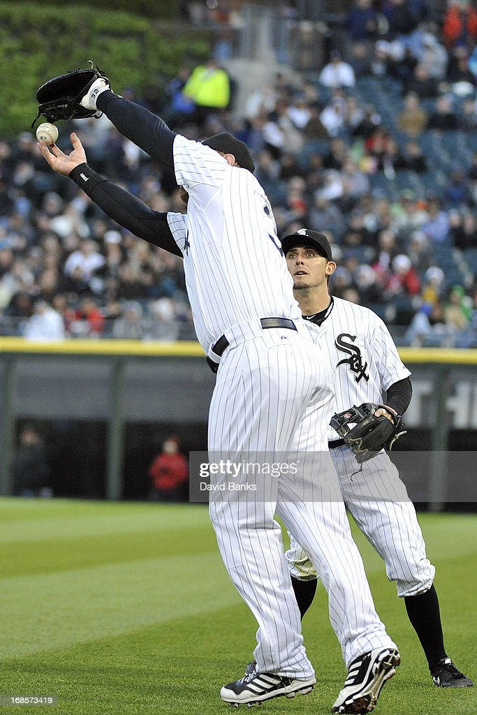 <a gi-track='captionPersonalityLinkClicked' href=/galleries/search?phrase=Adam+Dunn&family=editorial&specificpeople=213505 ng-click='$event.stopPropagation()'>Adam Dunn</a> #32 of the Chicago White Sox makes an error as teammate Tyler Greene #1 backs up the play during the fifth inning against the Los Angeles Angels of Anaheim on May 11, 2013 at U.S. Cellular Field in Chicago, Illinois.