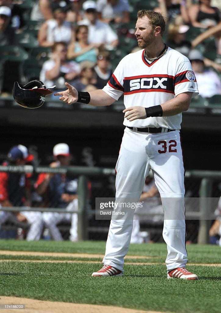 <a gi-track='captionPersonalityLinkClicked' href=/galleries/search?phrase=Adam+Dunn&family=editorial&specificpeople=213505 ng-click='$event.stopPropagation()'>Adam Dunn</a> #32 of the Chicago White Sox reads after striking out against the Atlanta Braves during the eighth inning on July 21, 2013 at U.S. Cellular Field in Chicago, Illinois. The Chicago White Sox defeated the Atlanta Braves 3-1.