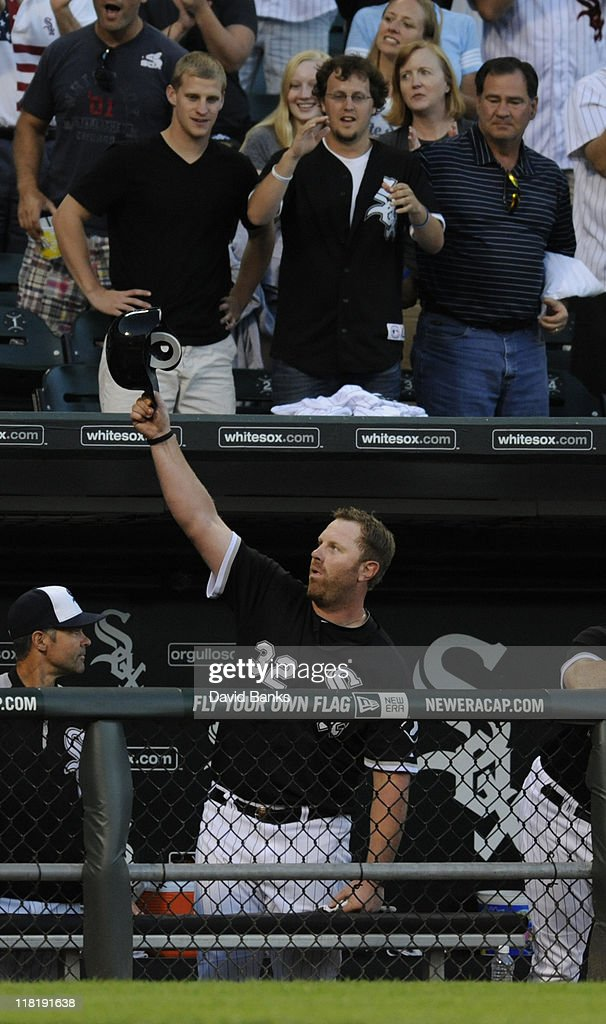 <a gi-track='captionPersonalityLinkClicked' href=/galleries/search?phrase=Adam+Dunn&family=editorial&specificpeople=213505 ng-click='$event.stopPropagation()'>Adam Dunn</a> # 32 of the Chicago White Sox tips his cap after hitting a two-run home run in the eighth inning against the Kansas City Royals on July 4, 2011 at U.S. Cellular Field in Chicago, Illinois.