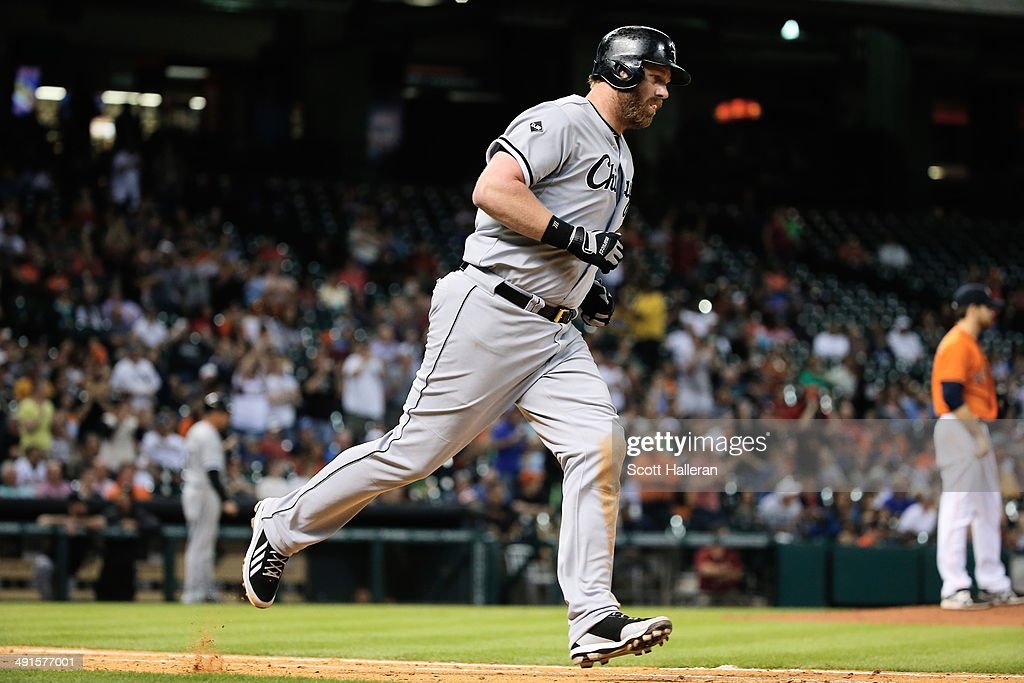 <a gi-track='captionPersonalityLinkClicked' href=/galleries/search?phrase=Adam+Dunn&family=editorial&specificpeople=213505 ng-click='$event.stopPropagation()'>Adam Dunn</a> #44 of the Chicago White Sox trots to first base after hitting a three-run home run to right field in the sixth inning off <a gi-track='captionPersonalityLinkClicked' href=/galleries/search?phrase=Collin+McHugh&family=editorial&specificpeople=9660247 ng-click='$event.stopPropagation()'>Collin McHugh</a> #31 of the Houston Astros during their game at Minute Maid Park on May 16, 2014 in Houston, Texas.