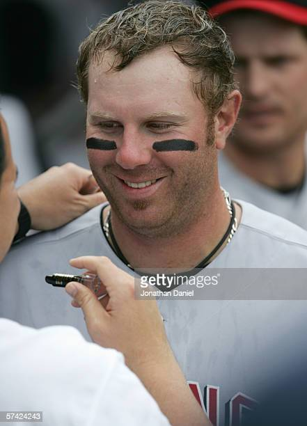 Adam Dunn of the Cincinnati Reds has black marker drawn under his eyes before the game against the Chicago Cubs on April 12 2006 at Wrigley Field in...