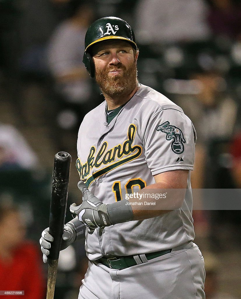 Adam Dunn of the Oakland Athletics reacts after striking out in the 9th inning against the Chicago White Sox at US Cellular Field on September 10...