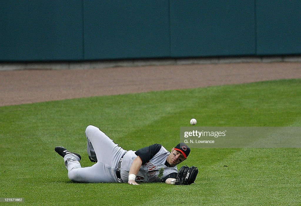 <a gi-track='captionPersonalityLinkClicked' href=/galleries/search?phrase=Adam+Dunn&family=editorial&specificpeople=213505 ng-click='$event.stopPropagation()'>Adam Dunn</a> of the Reds can't make the catch during action between the Cincinnati Reds and the St. Louis Cardinals at Busch Stadium in St. Louis, Missouri on April 15, 2006. St. Louis won 9-3.