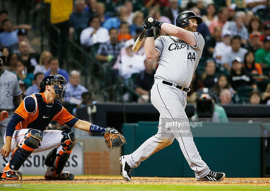 Adam Dunn#44 of the Chicago White Sox hits a three-run home run to right field in the sixth inning of their game against the Houston Astros at Minute Maid Park on May 16, 2014 in Houston, Texas.